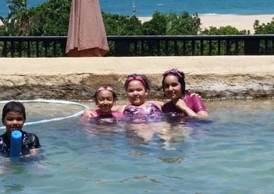 Kids in the Sugar Beach Resort pool